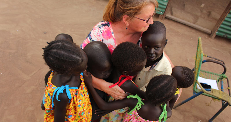 Rosa Ewing hugs children in Tonj